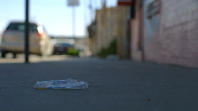 Man Steps on Sidewalk Litter video