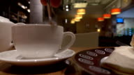 Man stirring tea in the cup a cafe. FullHD close up shot video