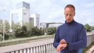 LD Man stretching and checking watch before jogging video