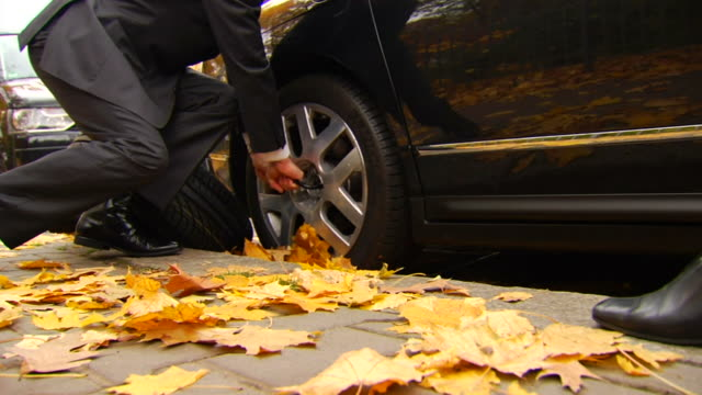Man Struggles to Remove Tire - Wife Approaches video
