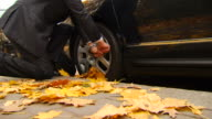 Man Struggles to Unbolt Tire video
