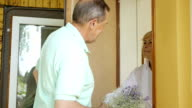 Man surprises his wife a bouquet of flowers. video