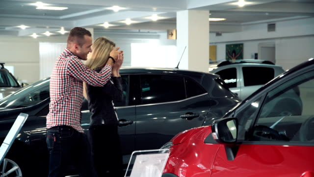 Man Surprising Woman with New Car In Show Room video