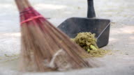 Man sweeping ground with a broom video
