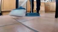 Man Sweeping Tile Floor video