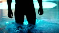 Man Swimmer Gets Into Water In Luxurious Swimming Pool video