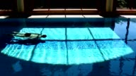 Man Swimming Underwater In Luxurious Swimming Pool video