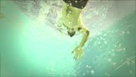 Man swimming: underwater view video