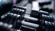man takes a dumbbell video