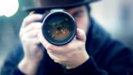 man takes a photo video