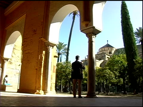 Man takes photo of La Mequite Mosque in Cordoba Spain video