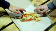 Man takes the last piece of pizza at lunch. Gender video