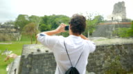 Man Taking a Shot of Mayan Temples video