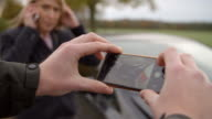 Man Taking Photo Of Car Accident On Mobile Phone video