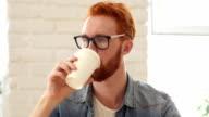 Man Taking Sip of Coffee, Sitting in Office video