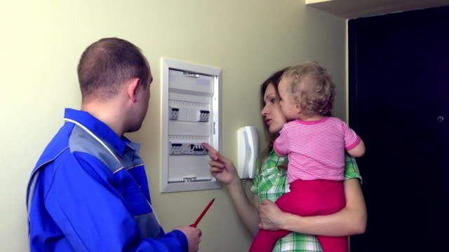 man talk with woman with baby in hand to circuit breaker. FullHD video