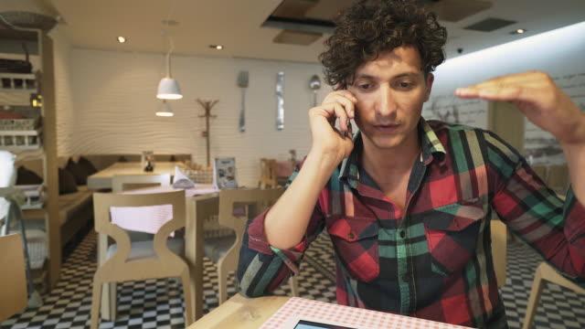 Man talking at mobile phone. video