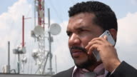 Man Talking On Cell Phone Near Cell Tower video