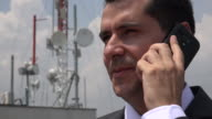 Man Talking On Phone Near Cell Tower video