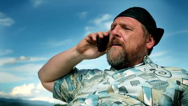 Man talking on the phone video