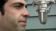 Man talks to microphone. Closeup. video