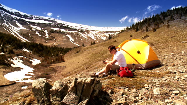 Man Tenting in Mountains, Talks on Mobile video