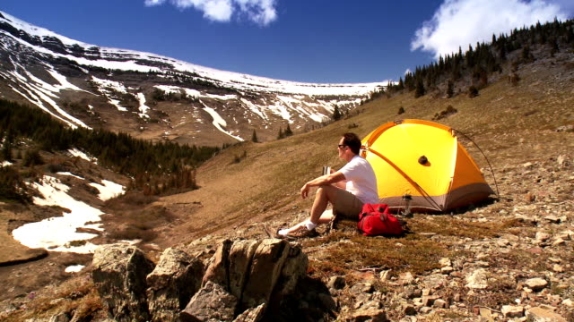 Man Tenting in Mountains video
