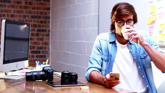 Man text messaging on mobile phone video