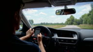 SLO MO Man text messaging while driving video