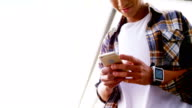 A man texting on his smartphone video