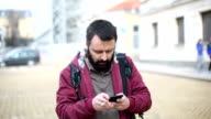 Man texting on smartphone video