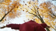 HD SLOW MOTION: Man Throwing Leaves In The Air video