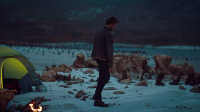 Man throwing some stones in the water video