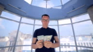 Man throws money. US Dollars video