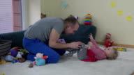 Man tickle toddler girl. video