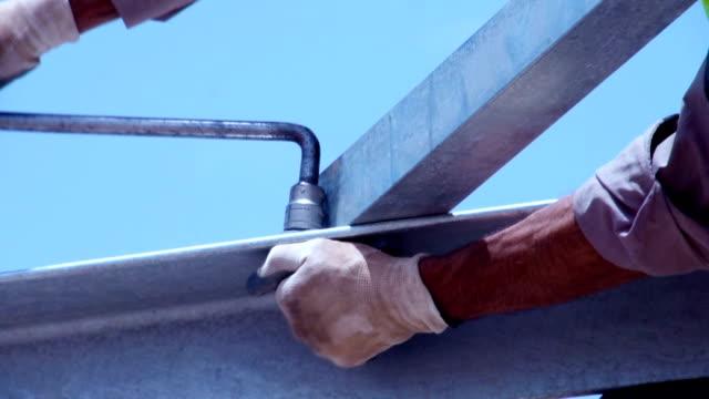 Man tightening a bolt or screw using a socket video