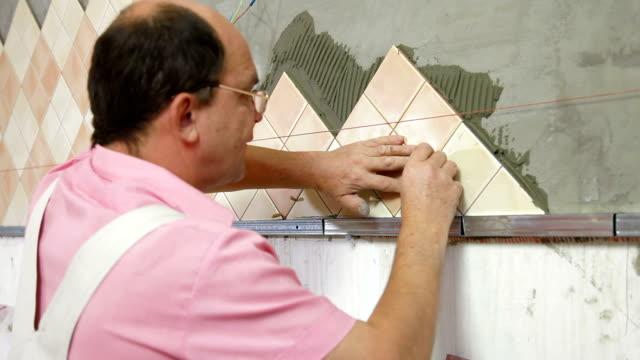 Man Tiling A Wall video