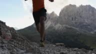Man trail running on Dolomites high mountain video