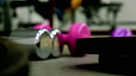 Man training exercising in gym, bumbbells in the front video
