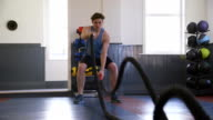 Man Training in Gym with Battle Ropes video