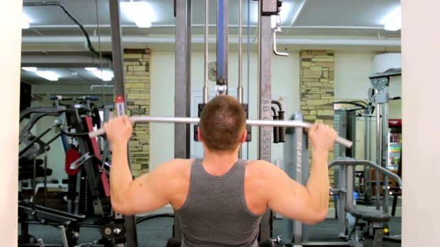 A man trains in a gym video