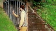Man tries to open secret door slow motion video