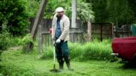 Man Trimming Grass video