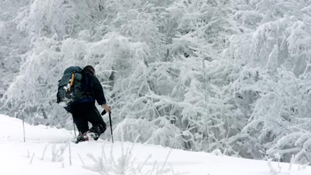 HD: Man Trudging Through Deep Snow video