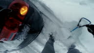 POV Man trying to dig car out of the snow video
