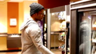 Man trying to get Money out of Vending Machine video
