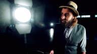 Man turning on studio light video