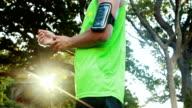 Man tying his smart watch in park video