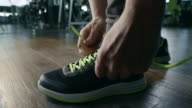 Man tying shoelaces video