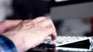 Man typing in a keyboard. video